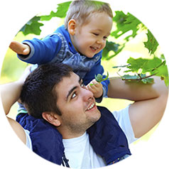 Man with his toddler son on his shoulders